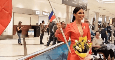 On Instagram, Gazini posted a photo as she arrived at the airport while waving the Philippine flag.